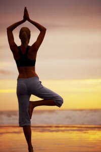 yoga pose on the beach at sunset